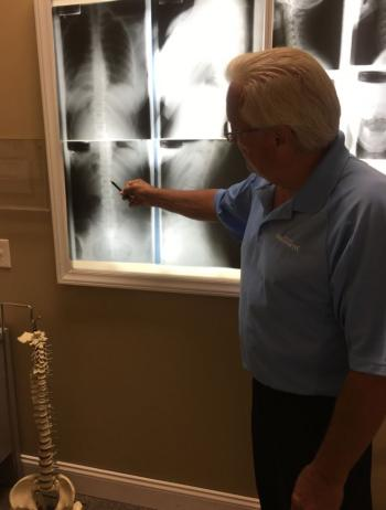 Dr. Simon looking at a patients xrays in Myrtle Beach